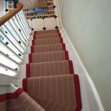 Roger Oates Dart Crimson with onsite hand sewn mitres supplied and installed by Bucklands Carpets & Flooring Redhill