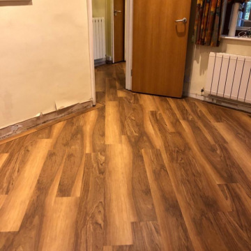Van Gogh design Lancewood with inset Chocolate border supplied and installed by Bucklands Carpets & Flooring