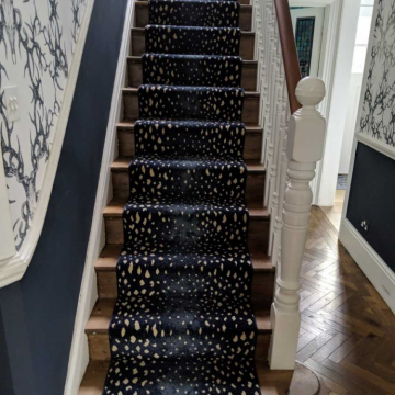Bespoke runner on stairs and landing supplied and installed by Millbank Carpets Hampton Hill