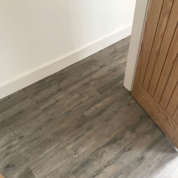Karndean Van Gogh Distressed Oak & Ulster Wellington Stripe Colour Quay supplied and installed by Arighi Bianchi