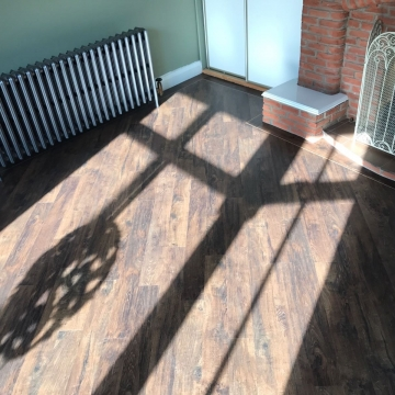 Spacia Rustic Barn Wood with a fused birch piping border supplied and installed by Michael John Carpets Leicester